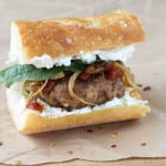 Gourmet Turkey Burger with goats cheese, sundries tomatoes and caramelized onions