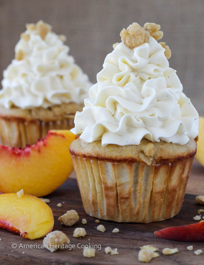 Peach Crisp Cupcakes filled with peach compote and topped with Swiss meringue buttercream