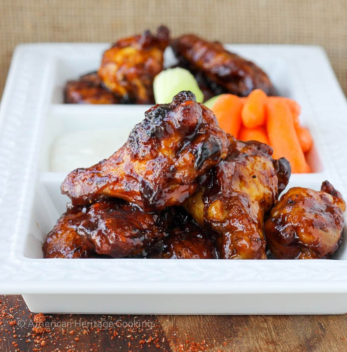 https://images.cheflindseyfarr.com/wp-content/uploads/2014/10/13090741/Saucy-Chipotle-Maple-Baked-Chicken-Wings-1410123509.jpg