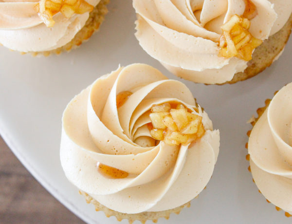 These Caramel Apple Cupcakes are a moist cinnamon cake filled with a spiced apple compote and are frosted with an easy salted caramel buttercream!