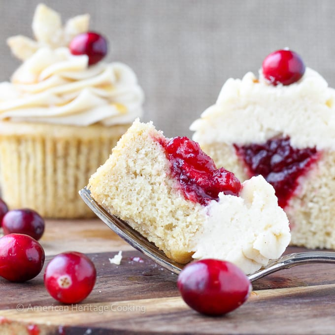 Spiced Apple Cider Cranberry Cupcakes | Soft, moist apple cider cinnamon cake filled with spiced cranberry compote and topped with a cinnamon cream cheese butter cream! And don't forget the sugared pie crust leaf!
