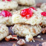 These easy Cherry Pecan Cookies are soft, chewy and nutty. A cream cheese sugar cookie is generously flavored with almond extract and rolled in pecans! My favorite Christmas Cookie recipe of all time!
