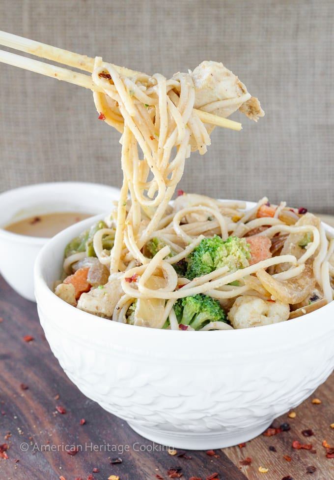 Dinner on the table in less than 20 minutes with this easy Thai Peanut Chicken Noodle Stir Fry!! | Mixed vegetables and chicken are tossed with whole wheat udon noodles and a spicy sweet Thai peanut sauce!