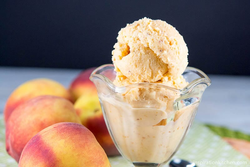 You will love this Fresh Peach Ice Cream | It's like taking a bite of the creamiest, frozen, ripest peach you can imagine wrapped in a sweet dessert!