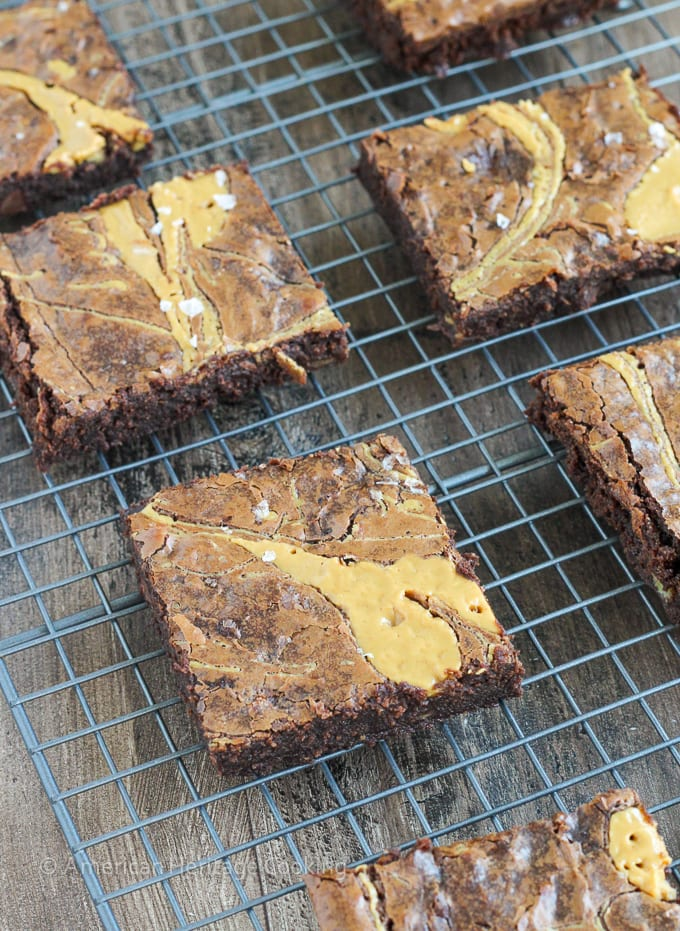 These Triple Chocolate Peanut Butter Banana Brownies are rich and chewy! The perfect combination of flavors! Plus a new way to use up those over-ripe bananas on your counter!