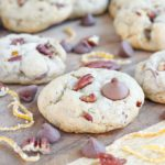 Soft, chewy cinnamon milk chocolate chip cookies with toasted pecans and candied orange peel. These Orange Pecan Milk Chocolate Chip cookies will have you reaching for another before you realize what you're doing!