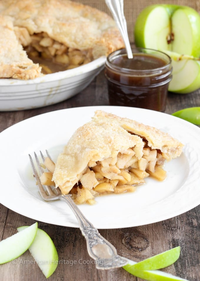 This Apple Butterscotch Pie is absolute heaven! Lightly spiced apples baked inside a flakey all-butter pie crust with a homemade brown sugar butterscotch sauce!