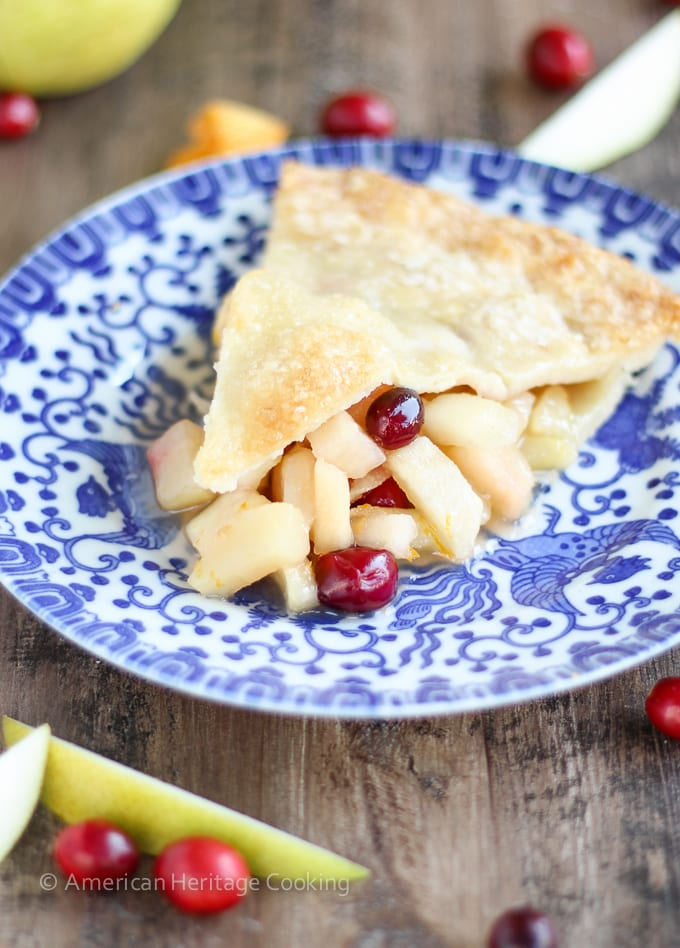 This Cranberry Orange Pear Pie has a sweet brown sugar orange pear filling and is studded with tart cranberries! With fresh orange juice, zest and Grand Marnier, the flavors are absolute heaven!