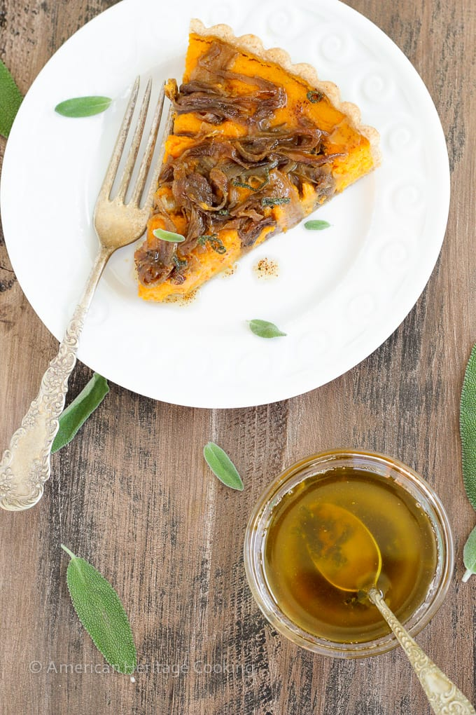 In this savory Butternut Squash Carrot Tart, carrots and butternut squash are roasted with Harissa and Hungarian paprika then covered in caramelized onions, and baked to custardy perfection in a whole-wheat tart shell. All topped with sage browned butter.