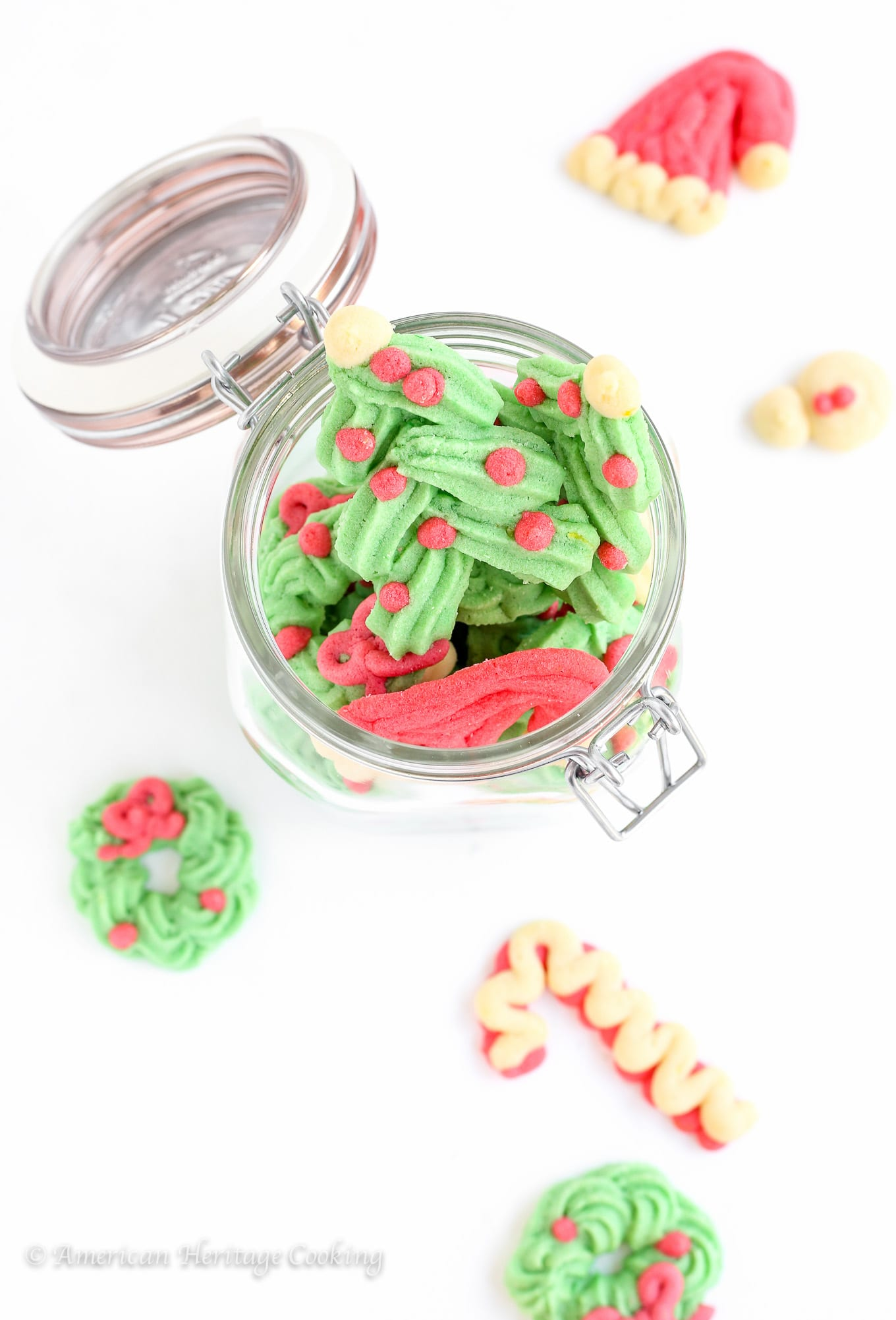 These festive Holiday Spritz Cookies are a light, delicate butter cookie flavored with vanilla and lemon.
