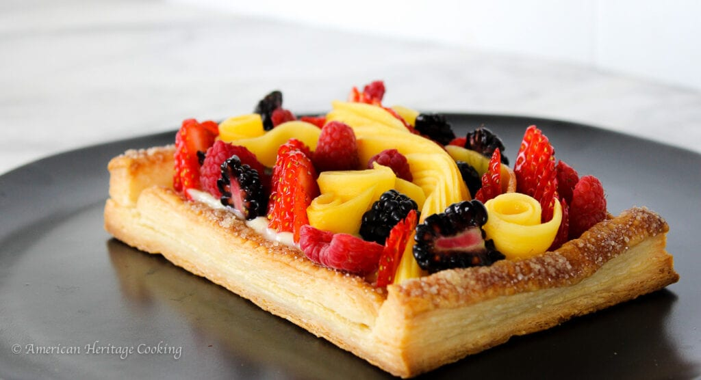 This Puff Pastry Fruit Tart is an easy stunning dessert! The base is puff pastry, filled with pastry cream and topped with your favorite fresh fruits!