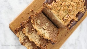 This easy cinnamon banana crumb bread has a chewy, crunchy streusel topping and is the perfect way to use up those old bananas! It's so easy that it is all made in one bowl with an immersion blender or in the blender!