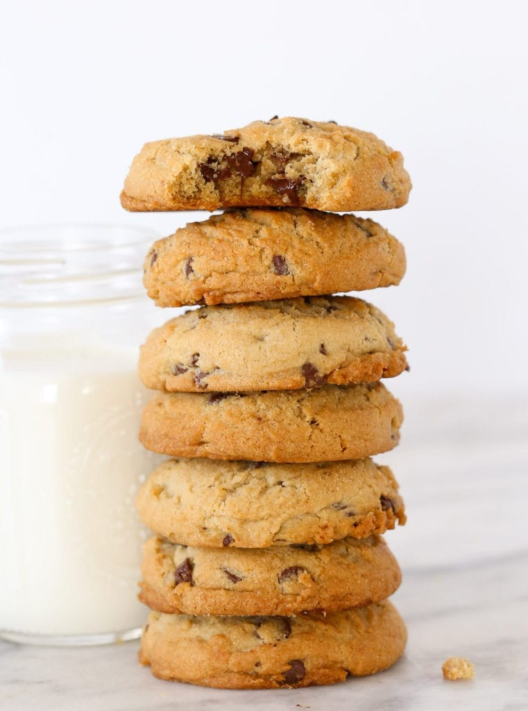 Chewy chocolate chip cookies with milk.