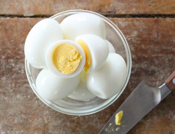 A professional pastry chef's easy recipe for the perfect hard boiled egg! You'll never need to look up how long to boil eggs again with this easy hard boiled egg recipe. Learn the trick to hard boiled eggs peeling easily every single time!