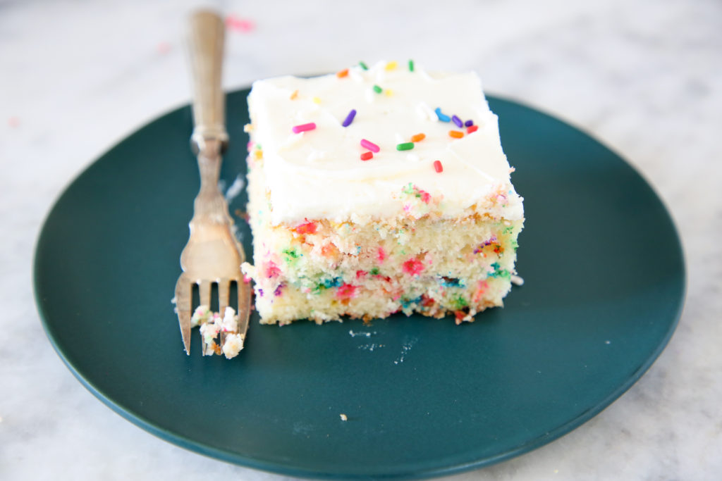 This Funfetti Sheet Cake is decadently moist and packed full of rainbow sprinkles!